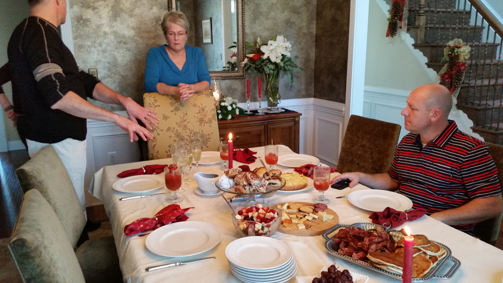 Keith tells his sister Barbara how to serve Christmas brunch