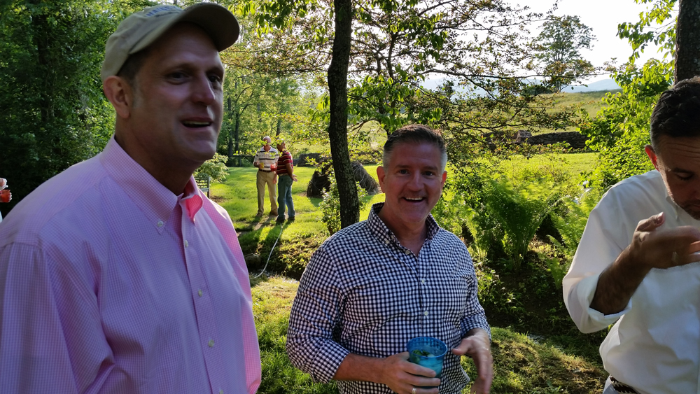 Keith confers with Drew at Will & Joe's garden party