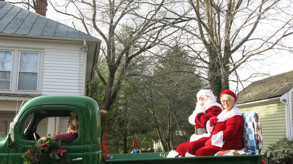 Santa and Mrs Claus end the parade