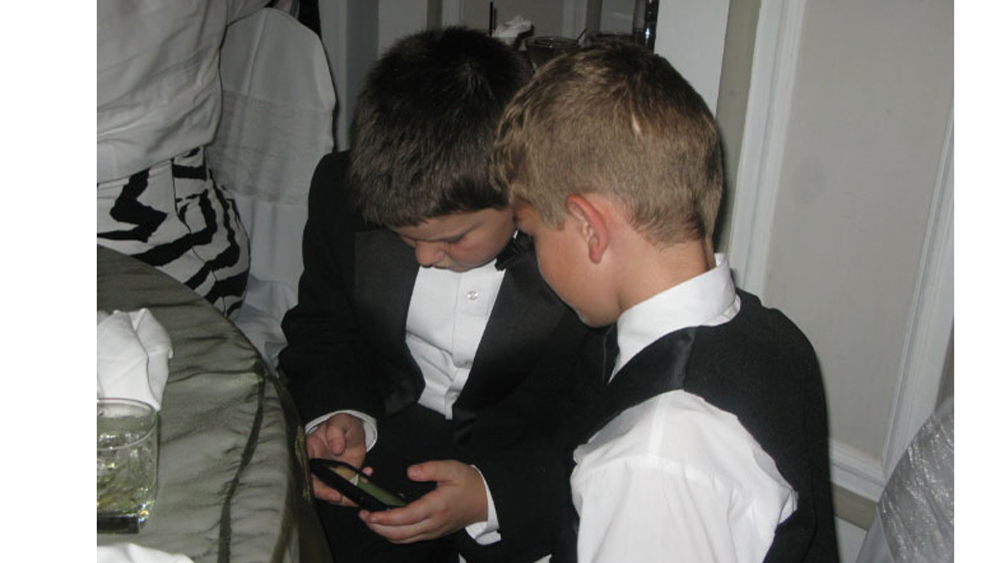 Luka and Stuart absorbed in Angry Birds