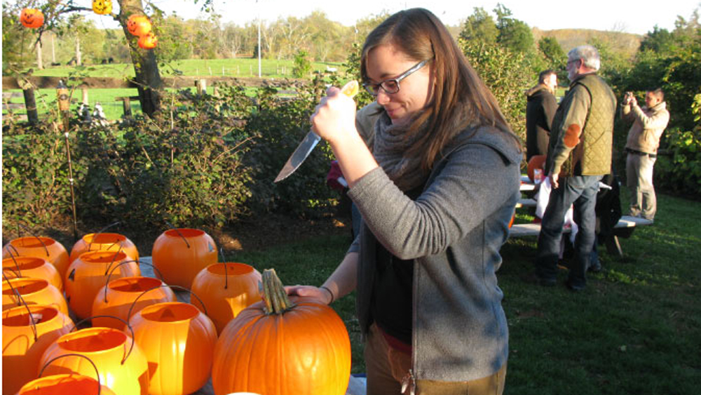 Stephanie carves her first pumpkin