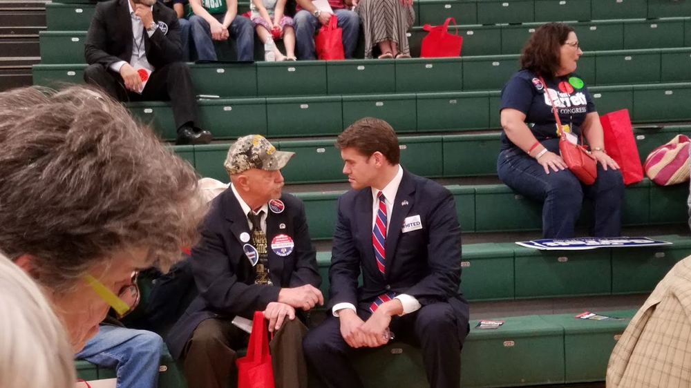 The Candidate listens to a veteran